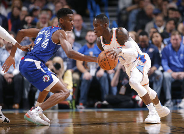 Dennis Schroder tries to drive around Shai Gilgeous-Alexander in a Thunder-Clipper game last October. (Photo by Sarah Phipps)