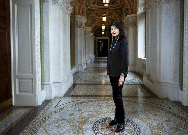 "In this June 6, 2019, photo, Joy Harjo, of the United States, poses inside the Library of Congress, in Washington. Harjo has been named the country's next poet laureate, becoming the first Native American and first Oklahoman to hold that position. Librarian of Congress Carla Hayden announced Harjo's appointment, saying in a statement today that the poet helped tell an American story of continuity and disruption, ""eckoning and myth-making."" Harjo's one-year term begins this fall. She succeeds Tracy K. Smith, who served two terms. [Shawn Miller/Library of Congress]"