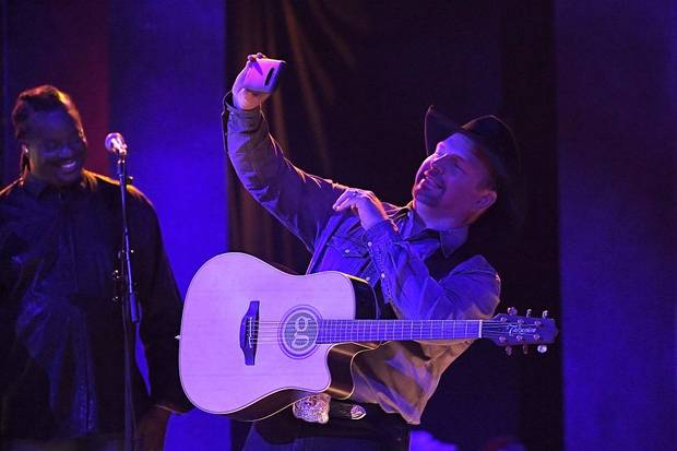 "Garth Brooks performs ""Dive Bar"" at the 53rd annual CMA Awards at Bridgestone Arena, Wednesday, Nov. 13, 2019, in Nashville, Tenn. [AP Photo/Mark J. Terrill]"