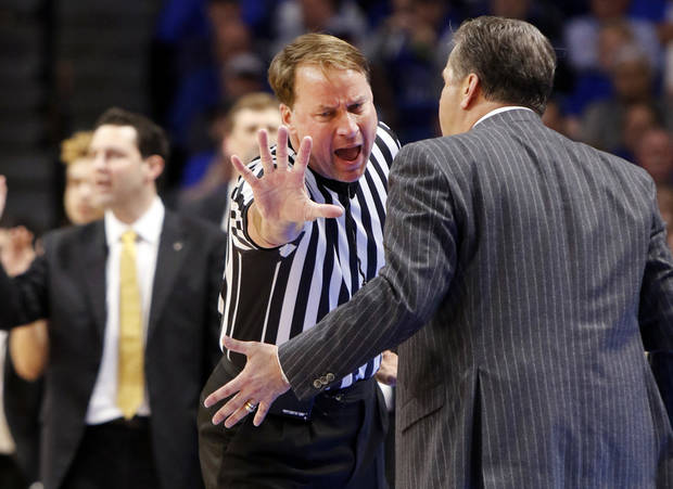 FILE - In this Feb. 28, 2017, file photo, Kentucky head coach John Calipari, right, address official John Higgins after being assessed a technical foul during the second half of an NCAA college basketball game against Vanderbilt, (AP Photo/James Crisp, File)