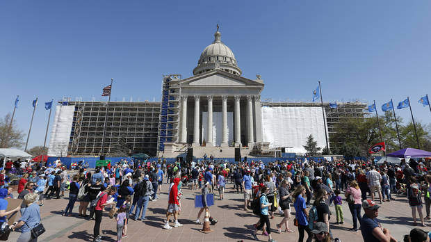 Teachers and supporters of increased education funding continue to rally on the south side of the state Capitol on the 11th day of a walkout by Oklahoma teachers in Oklahoma City, Thursday, April 12, 2018. Photo by Nate Billings, The Oklahoman