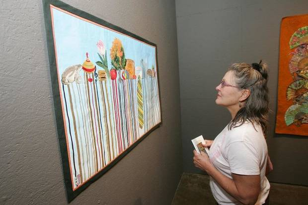 Cynthia Brown, of Tulsa, looks at work by B.J. Adams at Artspace at Untitled in Oklahoma City, Oklahoma July 31, 2009. [The Oklahoman Archives]
