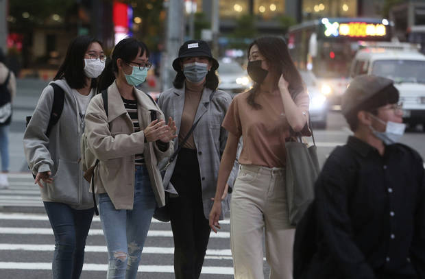 The Latest: Taiwan sees relative success in curbing virus