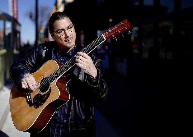 Edgar Cruz plays at the Automobile Alley streetcar stop in Oklahoma City, Saturday, Dec. 15, 2018. The popular OKC guitarist will perform Saturday during the Scissortail Park grand opening weekend. [Sarah Phipps/The Oklahoman Archives]