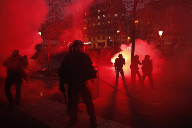 Paris police use tear gas amid strike over pension reform