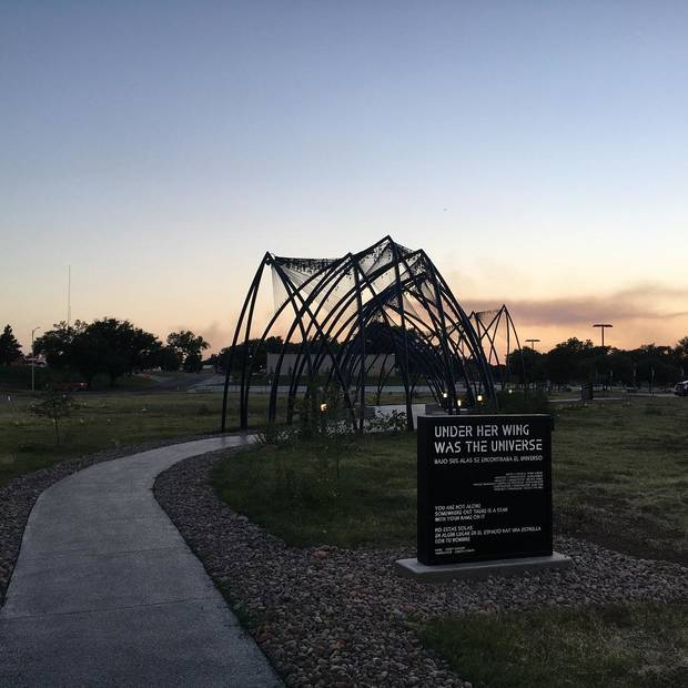 "Enid artist Romy Owens' large-scale public artwork ""Under Her Wing Was the Universe"" is seen at dusk. [Provided photo]"
