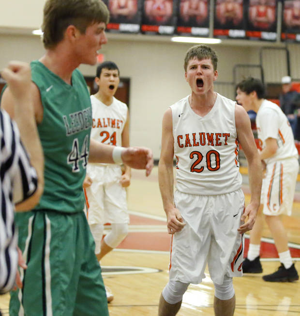 d642889b7ee Calumet s Gunner Snowden celebrates during a Class B boys basketball state  tournament game between Leedey and