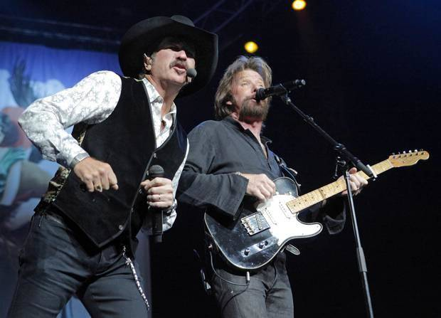"Kix Brooks, left, and Ronnie Dunn perform during the Brooks & Dunn concert as part of their ""Last Rodeo"" tour, at the Ford Center in Oklahoma City, Friday, August 20, 2010. [Photo by Nate Billings, The Oklahoman Archives]"