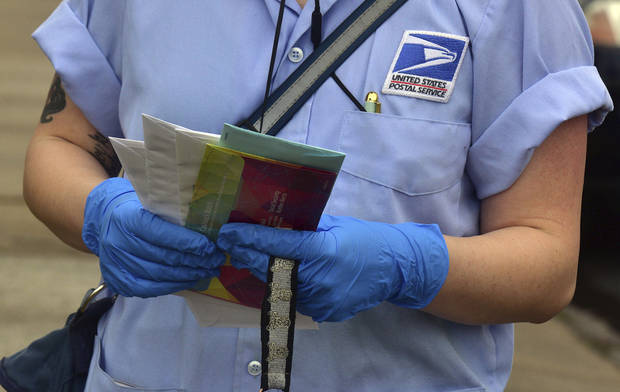 Coronavirus can live on surfaces for days. But it can't travel through the mail, experts say