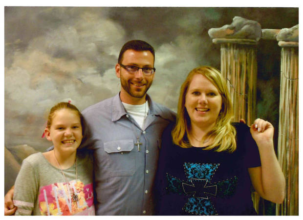 Chelsi and David Young with their daughter. Photo provided by Young family.