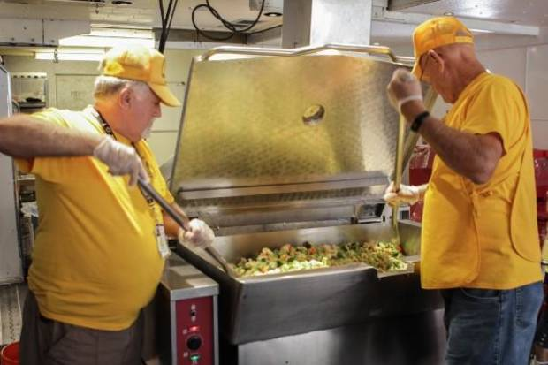 DR volunteers prepare food in the large feeding unit, which is stationed in The Woodlands, just outside of Houston. [Photo by Baptist General Convention of Oklahoma]