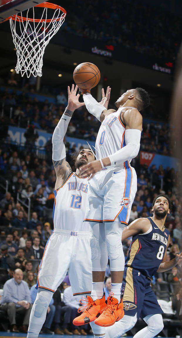 Oklahoma City's Russell Westbrook (0) grabs a rebound over Steven Adams (12) during an NBA basketball game between the Oklahoma City Thunder and the New Orleans Pelicans at Chesapeake Energy Arena in Oklahoma City, Thursday, Jan. 24, 2019. Photo by Bryan Terry, The Oklahoman