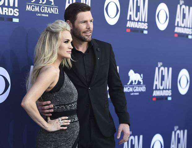 Carrie Underwood, left, and Mike Fisher arrive at the 54th annual Academy of Country Music Awards at the MGM Grand Garden Arena on Sunday, April 7, 2019, in Las Vegas. (Photo by Jordan Strauss/Invision/AP)