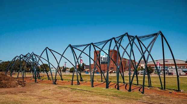 "Construction continues on artist Romy Owens' public art project ""Under Her Wing Was the Universe"" in Enid, Okla. on Thursday, Oct. 17, 2019. Devised as a pavilion that can be used for picnics, parties and other intimate events, Owens said the large-scale public art project will feature a sculptural cover with a starry light installation underneath, giving the sense of stepping under a large bird´s wing and discovering a universe under it. [Chris Landsberger/The Oklahoman]"