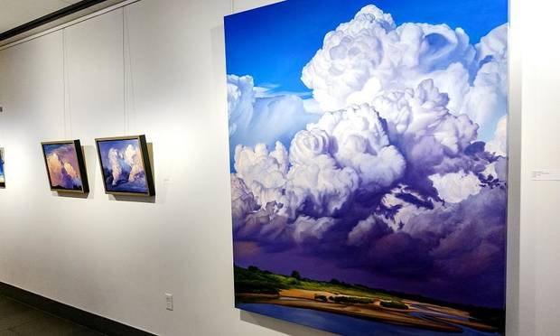 "David Holland's painting ""A Day in the Land of Giants"" is on display in his ""Capturing Clouds"" exhibit at the Visitor Center Lobby of the Crystal Bridge in Oklahoma City, Okla. on Monday, July 29, 2019. [Chris Landsberger/The Oklahoman]"