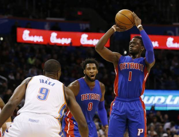 Detroit Pistons guard Reggie Jackson (1) shoots over Oklahoma City Thunder forward Serge Ibaka (9) during the first quarter of an NBA basketball game in Oklahoma City, Friday, Nov. 27, 2015. (AP Photo/Sue Ogrocki)