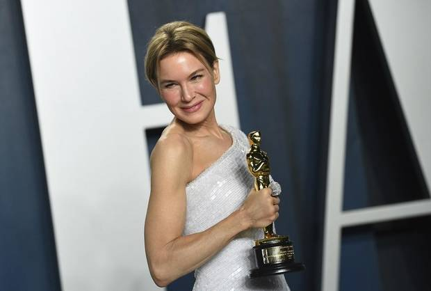 "Renee Zellweger, winner of the award for best performance by an actress in a leading role for ""Judy,"" arrives at the Vanity Fair Oscar Party on Sunday, Feb. 9, 2020, in Beverly Hills, Calif. [Photo by Evan Agostini/Invision/AP]"