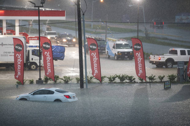 The Latest: Flooded interstate strands drivers in Texas
