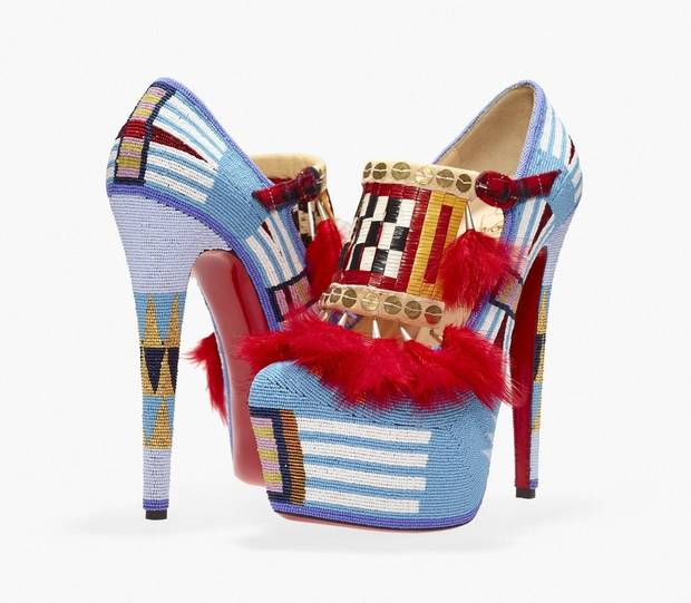"Jamie Okuma's (Luiseño/Shoshone-Bannock, born 1977), ""Adaption II"" are high-heel shoes designed by Christian Louboutin and adorned by the artist with feathers, glass beads, porcupine quills, sterling silver cones, brass sequins, chicken feathers, cloth, deer rawhide and buckskin. The shoes are included in the exhibit ""Hearts of Our People: Native Women Artists,"" on view through Jan. 3 at the Philbrook Museum of Art in Tulsa. [Photo provided]"