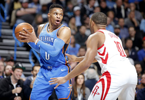 eca25faf347 Oklahoma City s Russell Westbrook (0) looks to pass as Houston s Eric  Gordon (10