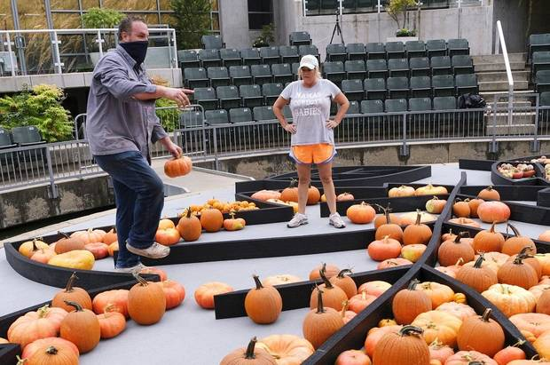 Local artist Nick Bayer gets help building a giant pumpkin mural on the Water Stage for the Myriad Botanical Gardens' Great Pumpkin Patch Friday, October 9, 2020 [Doug Hoke/The Oklahoman]