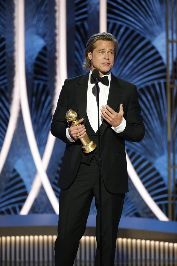 "Brad Pitt accepts the award for best supporting actor in a film for his role in & ""Once Upon A Time in Hollywood"" at the 77th Annual Golden Globe Awards at the Beverly Hilton Hotel in Beverly Hills, Calif., on Sunday, Jan. 5, 2020. [Paul Drinkwater/NBC via AP]"