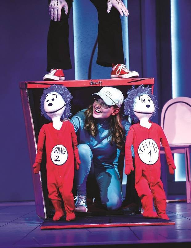 "Katelyn Curtin operates puppets for Thing 2 and Thing 1 during Lyric Theatre's production of ""The Cat in the Hat."" [K. Talley Photography]"