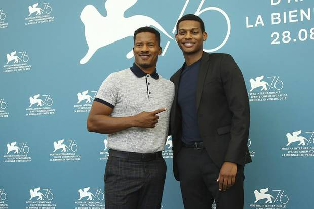 "Director Nate Parker, left, and actor Shane Paul McGhie pose for photographers at the photo call for the film ""American Skin"" at the 76th edition of the Venice Film Festival in Venice, Italy, Sunday, Sept. 1, 2019. [Photo by Joel C Ryan/Invision/AP]"