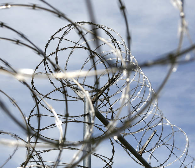 Razor wire on a fence at the North Fork Correctional Center in Sayre, Okla., Thursday, June 23, 2016. Photo by Kurt Steiss, The Oklahoman