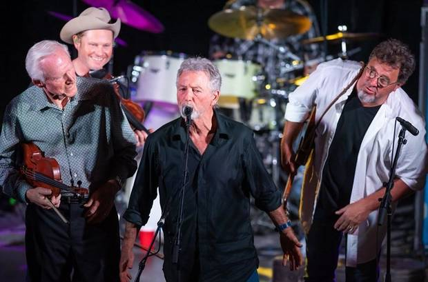 "Larry Gatlin, center, performs while, from left, Byron Berline, Turnpike Troubadours fiddler Kyle Nix and Vince Gill look on Tuesday night at ""The Music Never Dies"" benefit concert on behalf of Berline at Guthrie's historic Scottish Rite Temple. [Photo provided by Tom Dunning]"