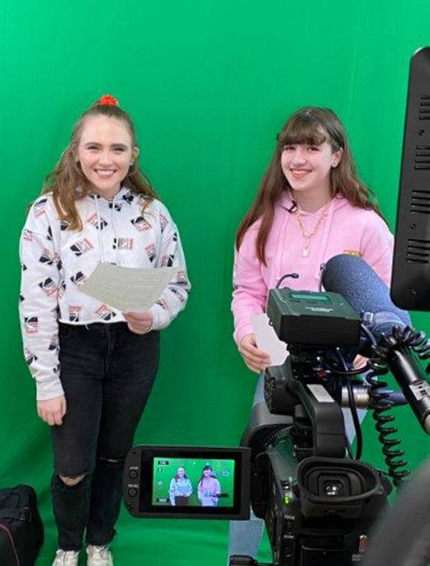 Kenzie Watson and Maycee Elerick prepare for a broadcast on the EPIC News Network.