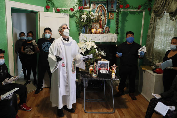 NY priest on virus front lines with embattled congregation