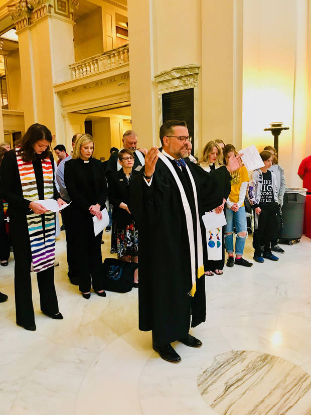The Rev. Mitch Randall, executive director of EthicsDaily.com and former senior pastor of NorthHaven Church in Norman, prays for teachers and public education at a prayer event on Thursday at the State Capitol. [Photo by Carla Hinton, The Oklahoman]