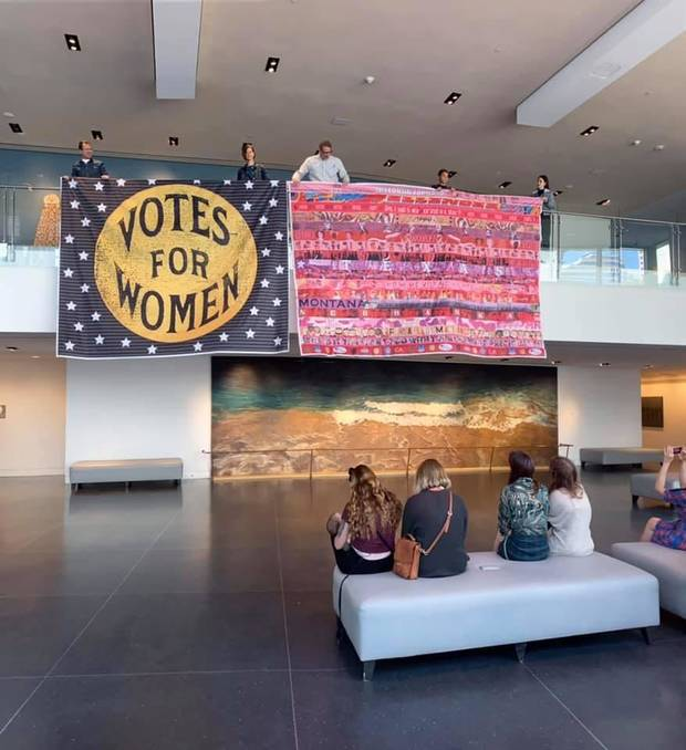 "The partially completed ""Her Flag"" art project is displayed at the Crocker Art Museum in Sacramento, California. Oklahoma City artist Marilyn Artus, who is spearheading the project, will sew the star field with its ""Votes for Women"" slogan onto the short stripes on the flag at an event Saturday at the Oklahoma History Center. [Photo provided]"