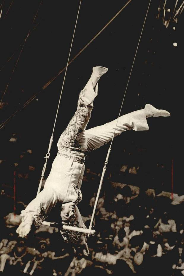 June 20, 1974: Thrilling the crowd at the Ringling Bros. and Barnum & Bailey Circus, the Great Balkanski balances on his trapeze. [Photo by Don Tullous, The Oklahoman Archives]