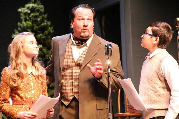 "From left, Ruth Daigle, Timothy Stewart, and Austin Barber appear in The Pollard Theatre's 2018 production of ""It's a Wonderful Life: A Live Radio Play"" at the historic downtown Guthrie theater. [Photo by Jennifer Jones]"