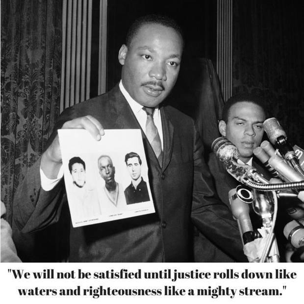 In the photo above from Dec. 4, 1964, civil rights leader Dr. Martin Luther King displays pictures of three civil rights workers who were slain in Mississippi the summer before. The photo was taken during a news conference in New York, during which King commended the FBI for its arrests in Mississippi in connection with the slayings.