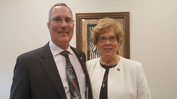 Patrick Raglow,, executive director of Catholic Charities of Oklahoma City, poses for a photo with Sister Donna Markham, Ph.D., Catholic Charities USA president and chief executive officer, during Markham's recent visit to Oklahoma City. [Photo by Carla Hinton, The Oklahoman]