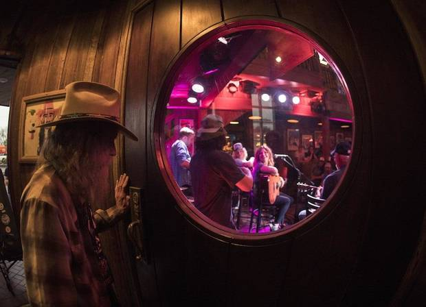 Randy Crouch watches some of his fellow songwriters perform at the 2018 Bob Childers' Gypsy Cafe songwriters festival at Eskimo Joe's in Stillwater. Crouch will recieve the Restless Spirit Award at this year's festival [Photo by Nathan Poppe]