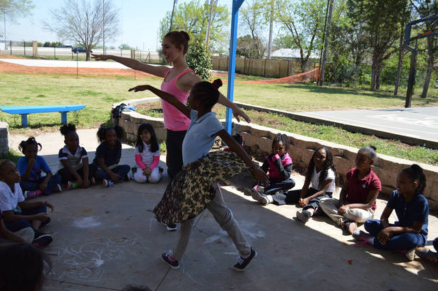 A OKC Ballet dancer with a student. Photo provided by OKC Ballet.