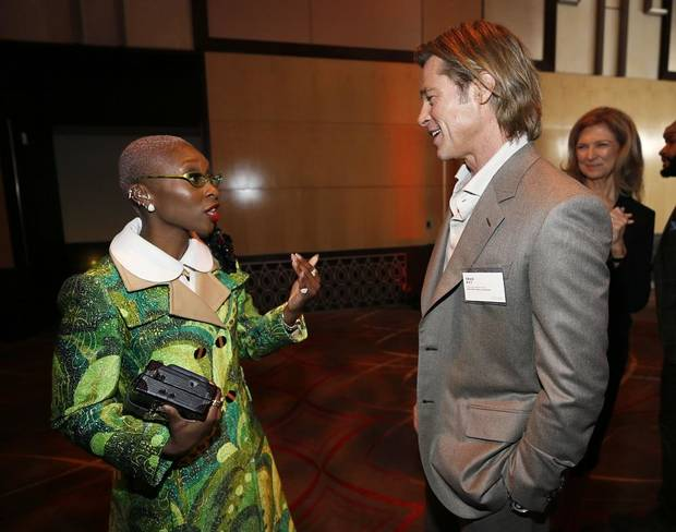 Cynthia Erivo, left, and Brad Pitt attend the 92nd Academy Awards Nominees Luncheon at the Loews Hotel on Monday, Jan. 27, 2020, in Los Angeles. [Photo by Danny Moloshok/Invision/AP]
