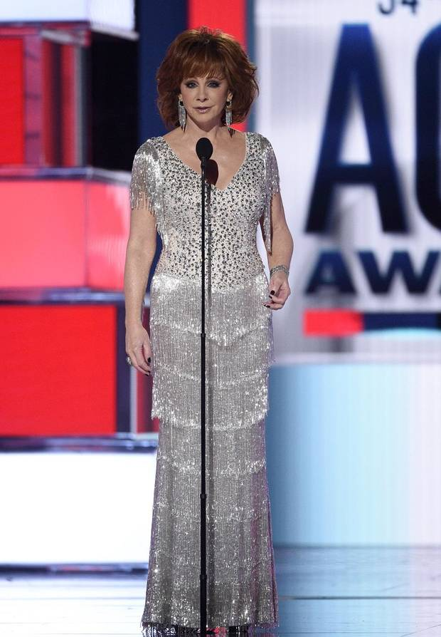 Host Reba McEntire speaks at the 54th annual Academy of Country Music Awards at the MGM Grand Garden Arena on Sunday, April 7, 2019, in Las Vegas. (Photo by Chris Pizzello/Invision/AP)