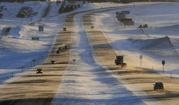 Tribune Strong winds and ground blizzard conditions greeted motorists on Interstate 94 around sunrise, Thursday, Jan. 12, 2017, west of Mandan, N.D. An Arctic cold front entered the state with winds gusting to 55 mph reducing visibility along the interstate and causing hazardous travel conditions and dangerous wind chills. (Tom Stromme/The Bismarck Tribune via AP)