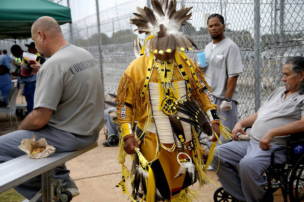Inmate David Arkinson, a Sioux, walks past other inmates during the 27th Annual Confined Inter-Tribal Group Gourd Dance & Pow-Wow inside Joseph Harp Correctional Center in Lexington, Okla., on Friday, September 9, 2016. Photo by Bryan Terry, The Oklahoman