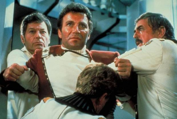 "From left, DeForest Kelley, William Shatner and James Doohan appear in ""Star Trek II: The Wrath of Khan."" The 1982 film will be screened prior to an appearance and Q&A by Shatner Friday at Norman's Riverwind Casino [Paramount Pictures photo]"