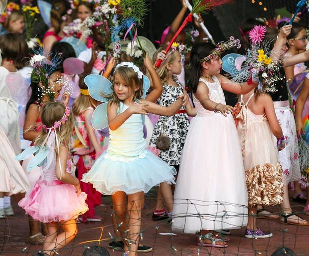 Children dance on stage during the 2018 Fairy Ball at the Crown Jewel Amphitheater at First Christian Church, 3700 N Walker Ave., in Oklahoma City, Saturday, June 16, 2018. The Fairy Ball is a yearly free children's event sponsored by the Paseo Arts Association and Theatre Upon a StarDanceSwan. [Nate Billings/The Oklahoman Archives]