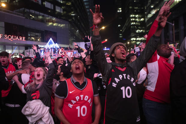 Toronto Raptors fans celebrate outside the arena in the closing seconds of Game 6 Saturday night. (The Canadian Press)