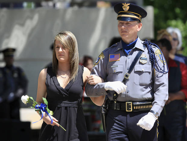 Wade Gourley escorted Sheridan Hoskins during a tribute to fallen officers in 2010, when he was a lieutenant. Gourley was named Oklahoma City police chief Monday. [Photo by Jim Beckel/The Oklahoman]