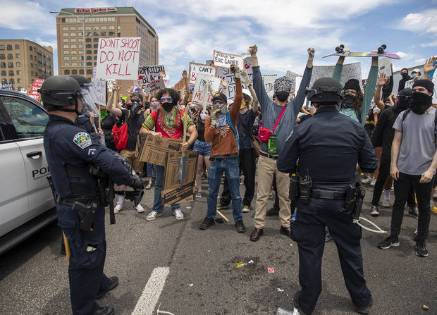 Protests heat up across US, governors call in National Guard
