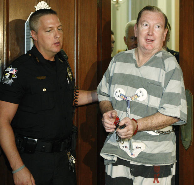 FILE - In this Monday, July 11, 2011 file photo, Jerome Ersland, right, is led from an Oklahoma County courtroom after he was sentenced to life with the possibility of parole for the May 2009 shooting of 16-year-old Antwun Parker, in Oklahoma City. On Monday, Ersland will request commutation of the life prison sentence. (AP Photo/Sue Ogrocki, File)